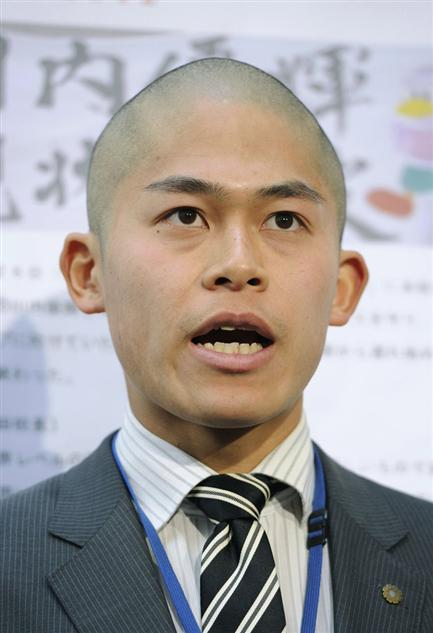 Asian men with shaved heads